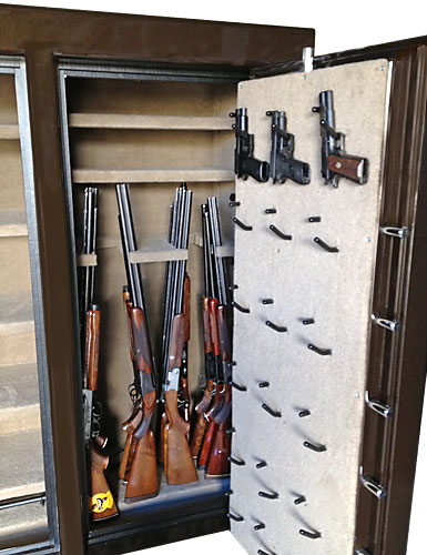 Double Wide gun safe interior with pistol holders and gun racks